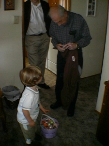 My Grandpa, helping my nephew open a plastic Easter egg on Easter morning 2007.